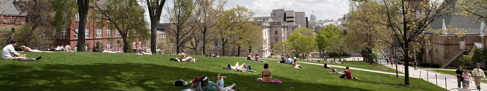 Students read and relax on Bascom Hill.