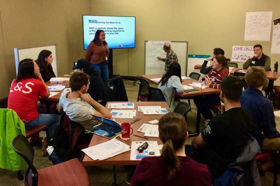 Social Justice Hub members gather around to talk.