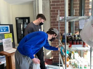Housing Equity members volunteer at a local food shelf.