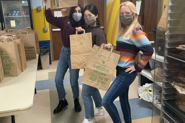 Volunteers package food to give to people visiting the food pantry.
