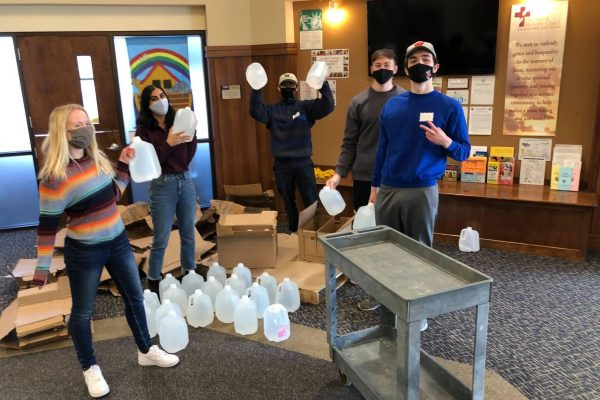 Volunteers gather water bottles at the First United Methodist Church food pantry.