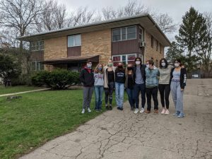 Housing Equity volunteers take a photo outside the property they cleaned up 4/10.